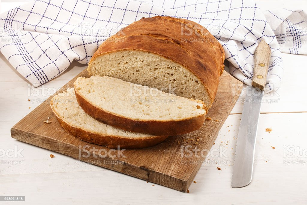 sliced home baked bread on a cutting board stock photo