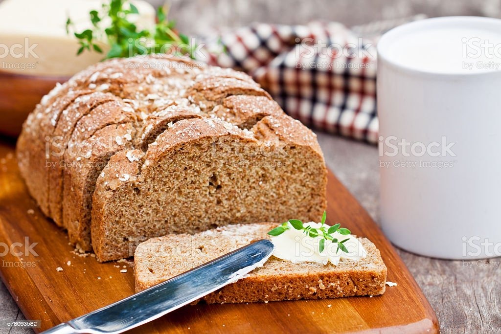 Sliced  Irish stoneground soda bread with butter and thyme stock photo