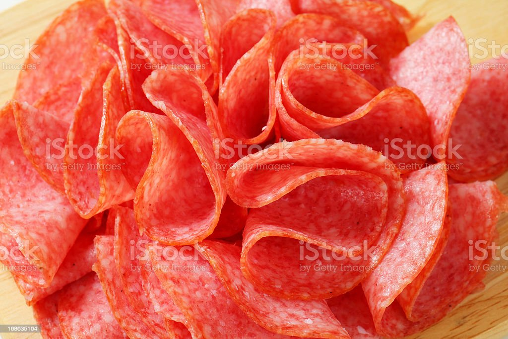 Sliced Italian salami on a cutting board royalty-free stock photo