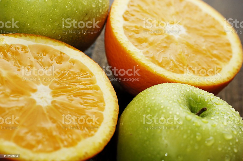 sliced juicy citrus oranges and green apples, fruit royalty-free stock photo