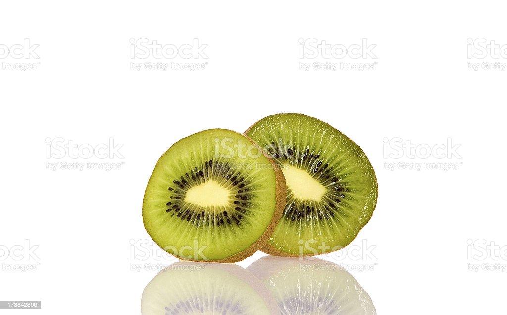 Sliced Kiwi on Reflective Surface stock photo