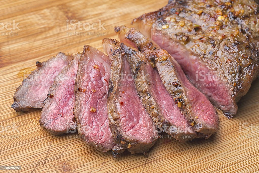 Sliced Kobe New York Steak on a Cutting Board royalty-free stock photo