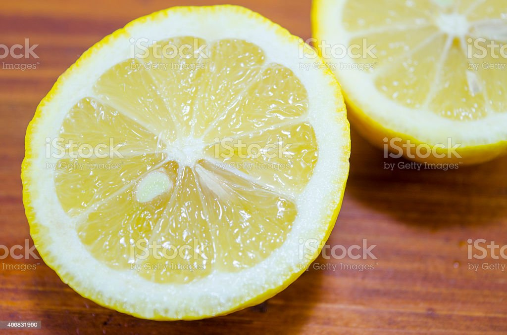 Sliced lemon on a wooden table royalty-free stock photo