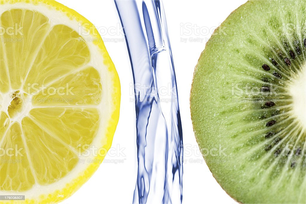 sliced lime with lemon splashing in water isolated royalty-free stock photo