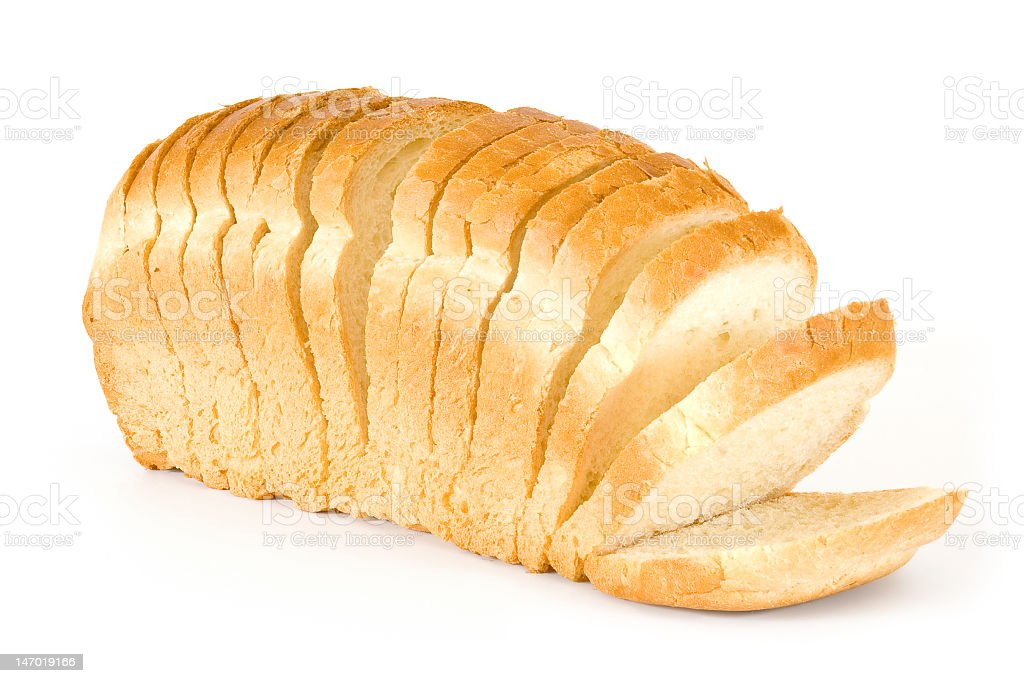 A sliced loaf of bread on a white background royalty-free stock photo