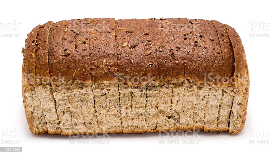 Sliced loaf of wholemeal brown bread on a white background royalty-free stock photo