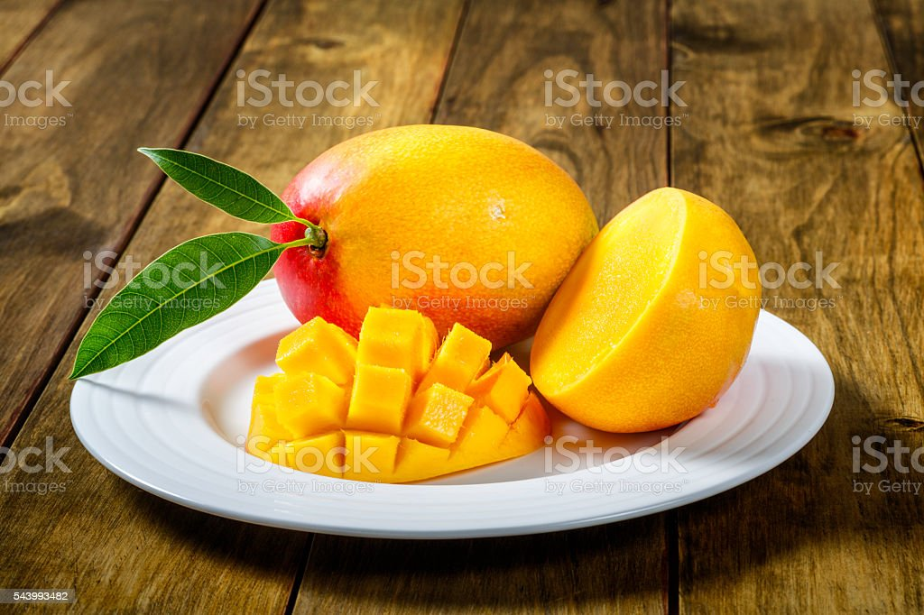 Sliced Mango on a plate ready for breakfast. stock photo