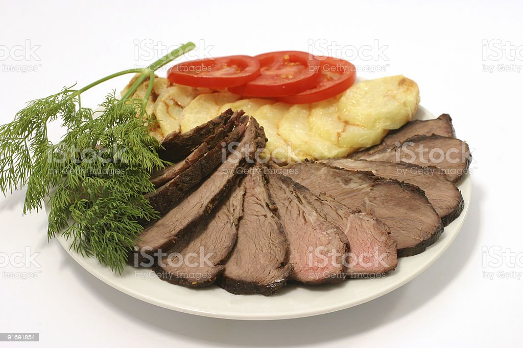sliced meat and potatoes royalty-free stock photo