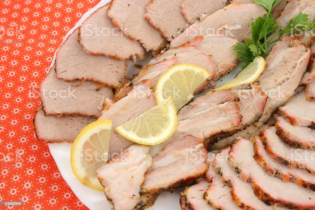Sliced meat with lemon royalty-free stock photo
