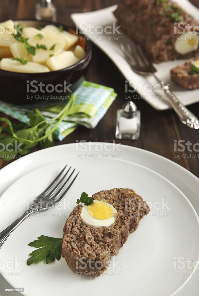 Sliced meatloaf with egg royalty-free stock photo