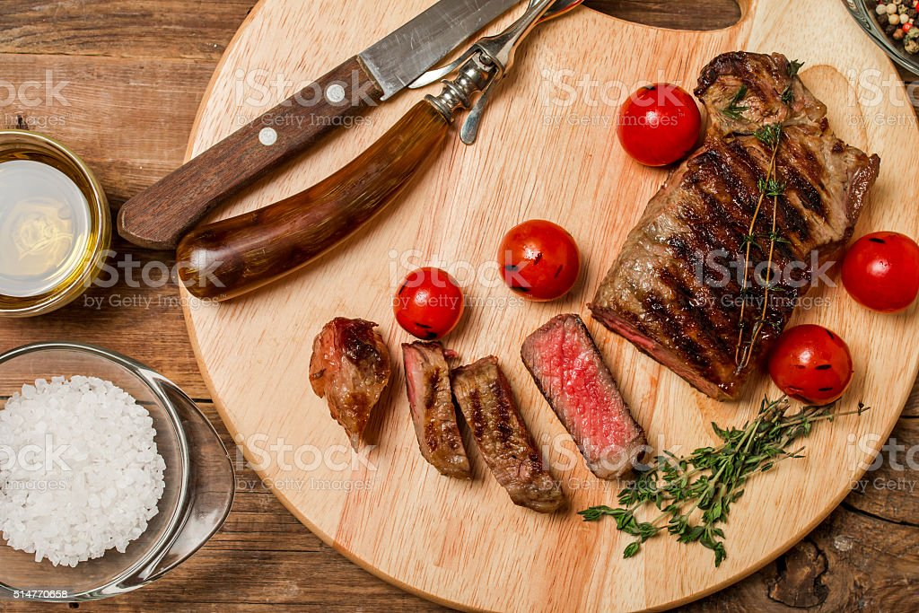 Sliced medium rare grilled Beef steak Ribeye stock photo