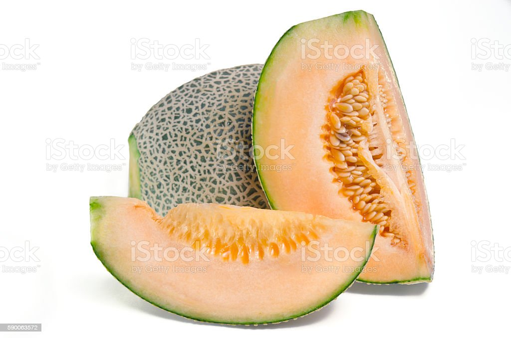 Sliced melon with seed on white (Other names are cantelope) stock photo