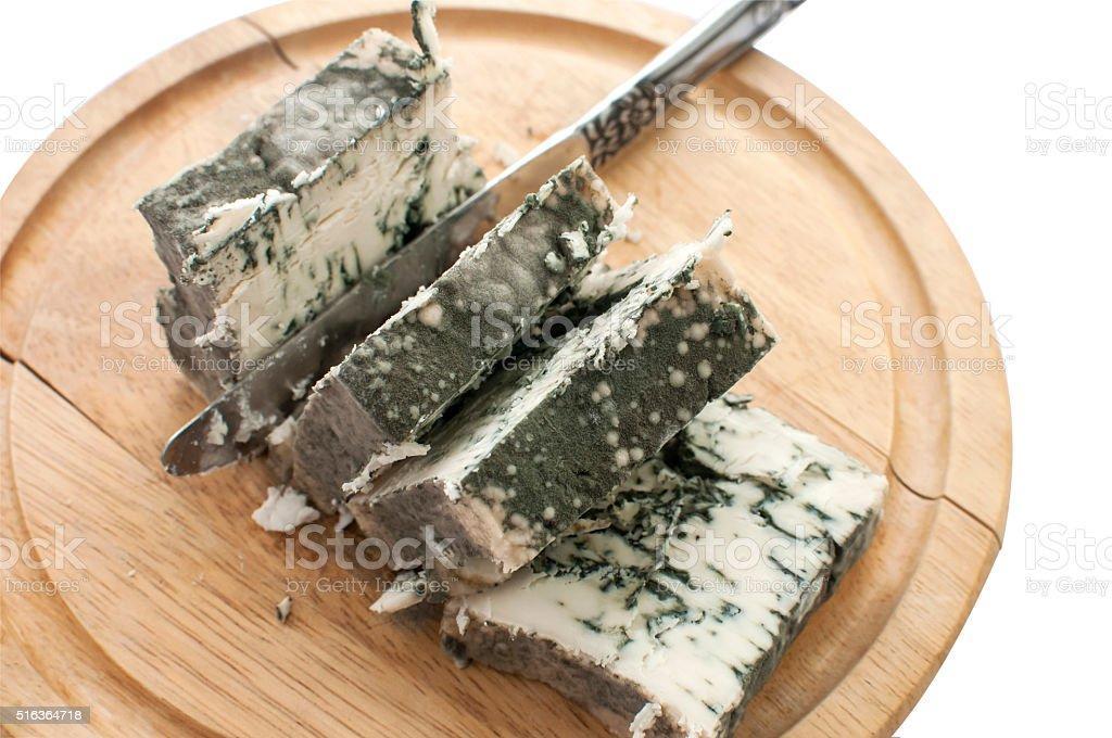 Sliced moldy lump of cheese stock photo