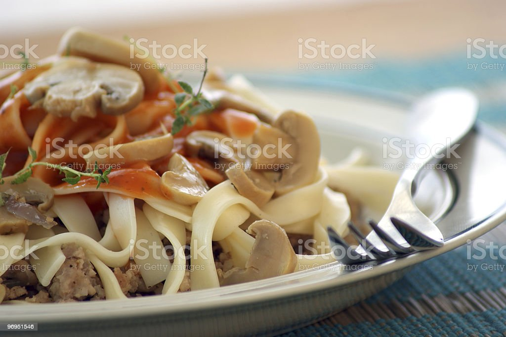 sliced mushroom and pasta with mince meat stock photo