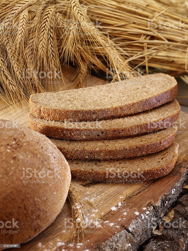 Sliced of bread with wheat stock photo