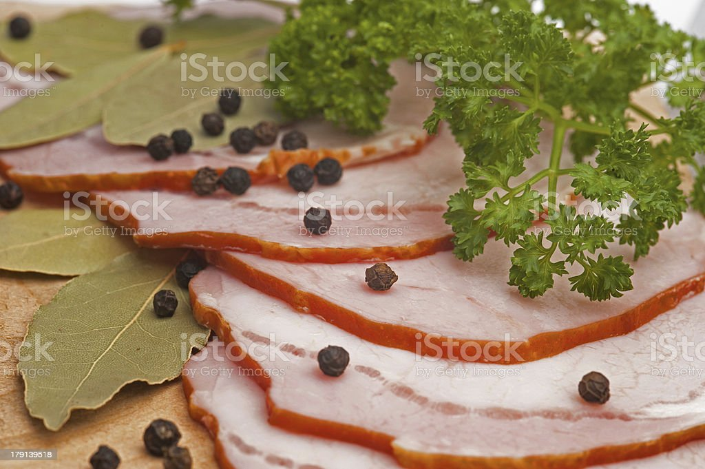Sliced of ham with spiceson royalty-free stock photo