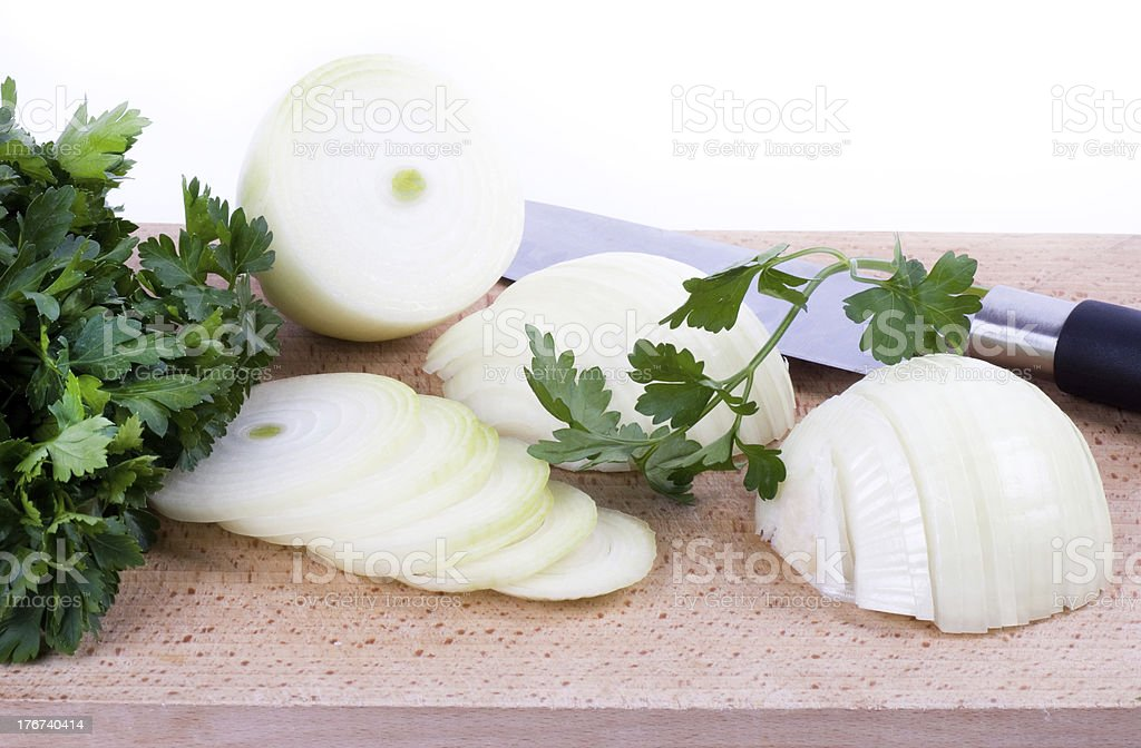 Sliced onion with knife isolated on white royalty-free stock photo