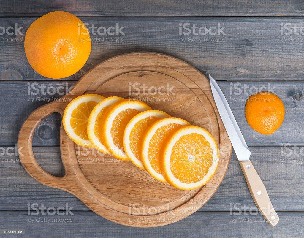 Sliced orange on cutting board. stock photo