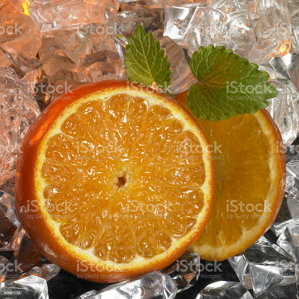 sliced oranges and ice cubes royalty-free stock photo