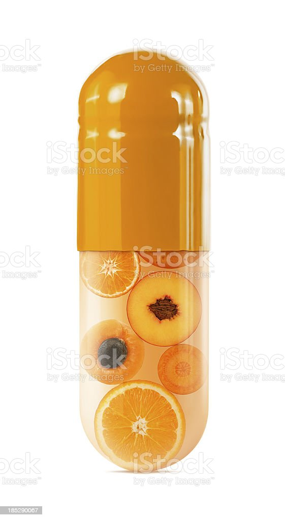 Sliced oranges in oversized capsule on white stock photo