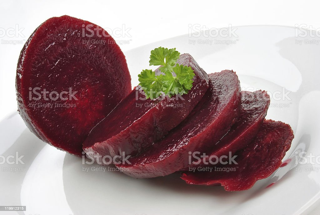sliced organic beet root on a white plate stock photo