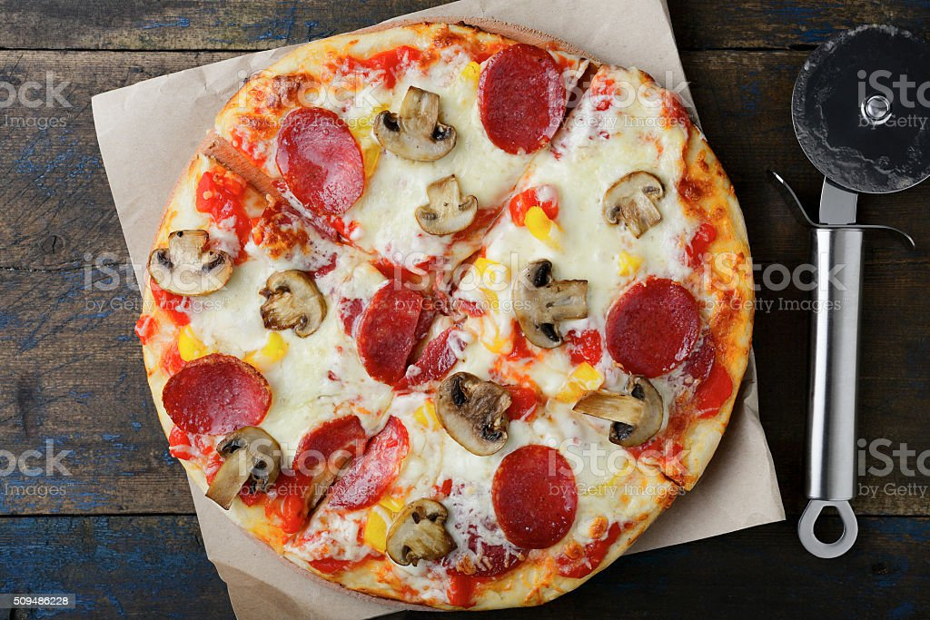 Sliced Pepperoni Pizza with mushrooms stock photo