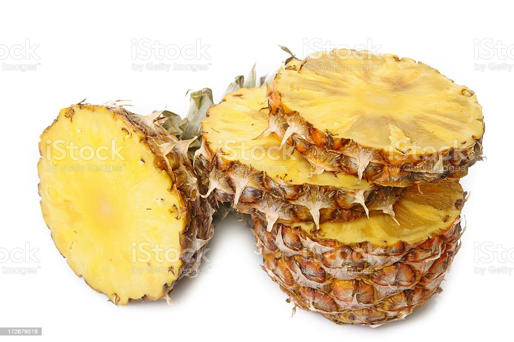 sliced pineapple on white stock photo