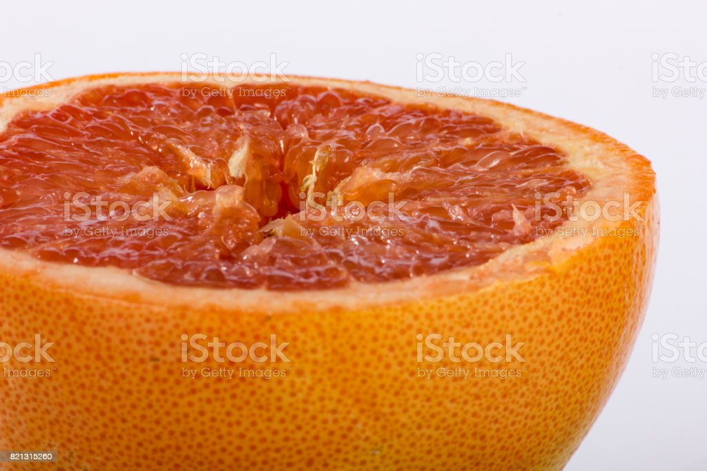 Sliced Pink Grapefruit Closeup stock photo