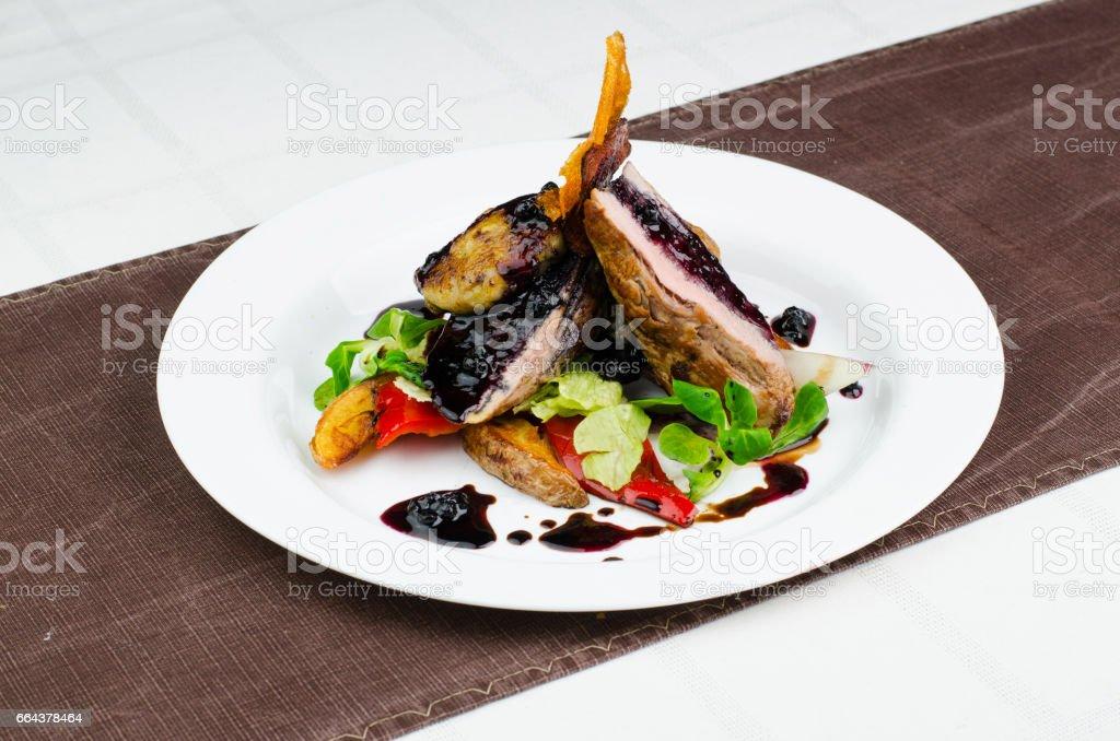 Sliced Pork Meat With Blueberry Jam stock photo