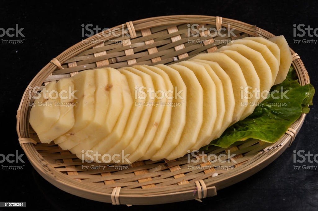 sliced potatoes stock photo