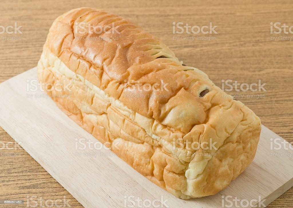 Sliced Raisin Bread on Wooden Cutting Board stock photo