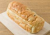Sliced Raisin Bread on Wooden Cutting Board