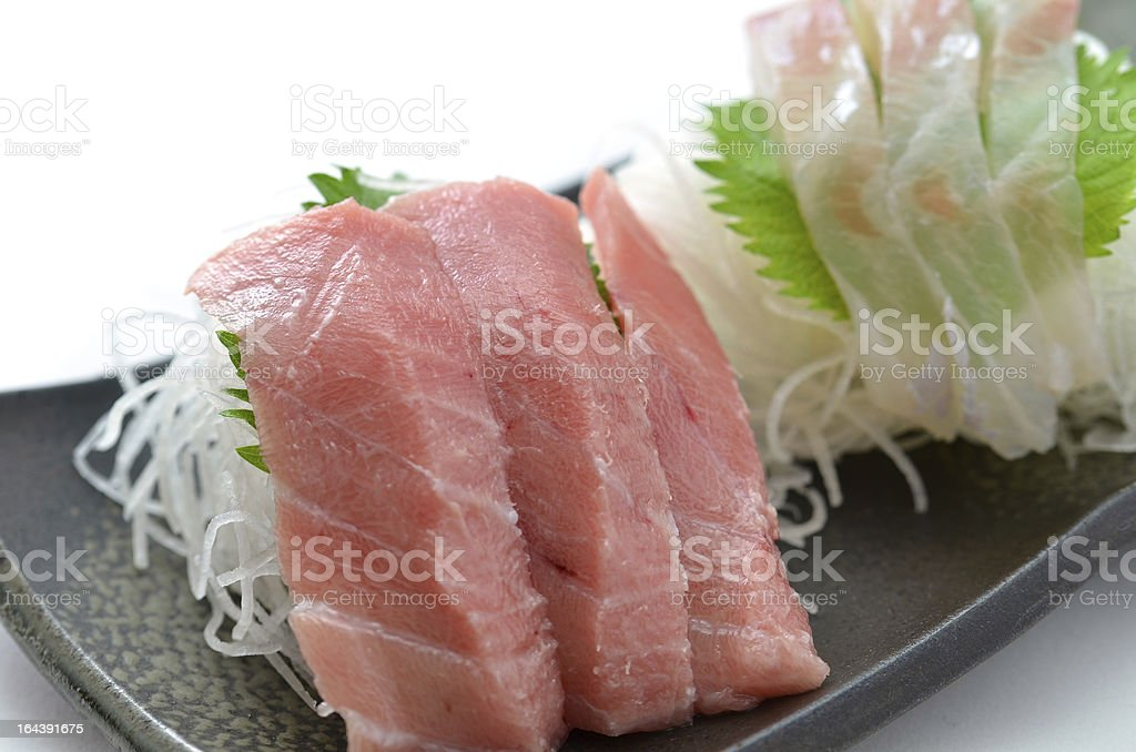 Sliced raw fish called Sashimi royalty-free stock photo
