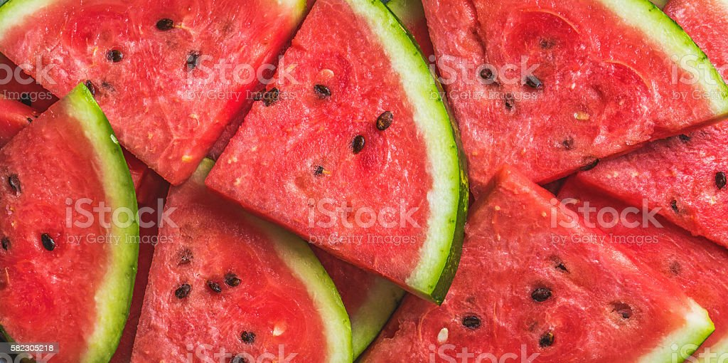 Sliced red ripe watermelon. Fruit background and texture. stock photo