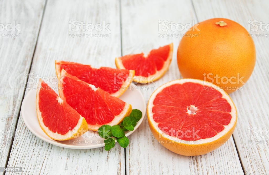 Sliced ripe grapefruits stock photo
