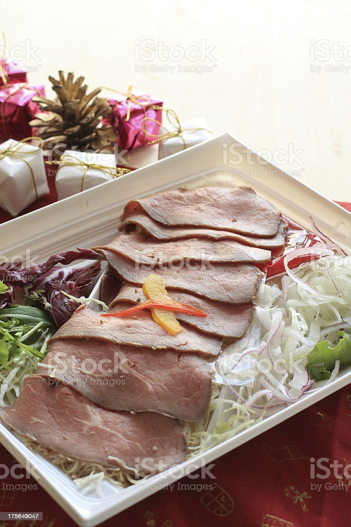 sliced roast beef and christmas ornament royalty-free stock photo