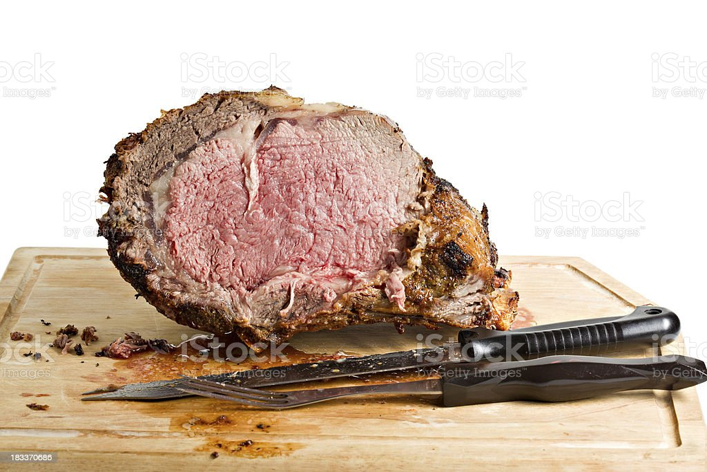 Sliced Roasted Prime Rib With Knife On Plank stock photo