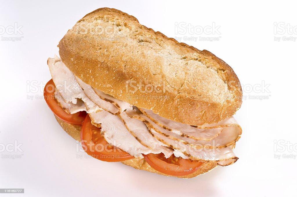 Sliced roasted turkey and tomato sandwich royalty-free stock photo