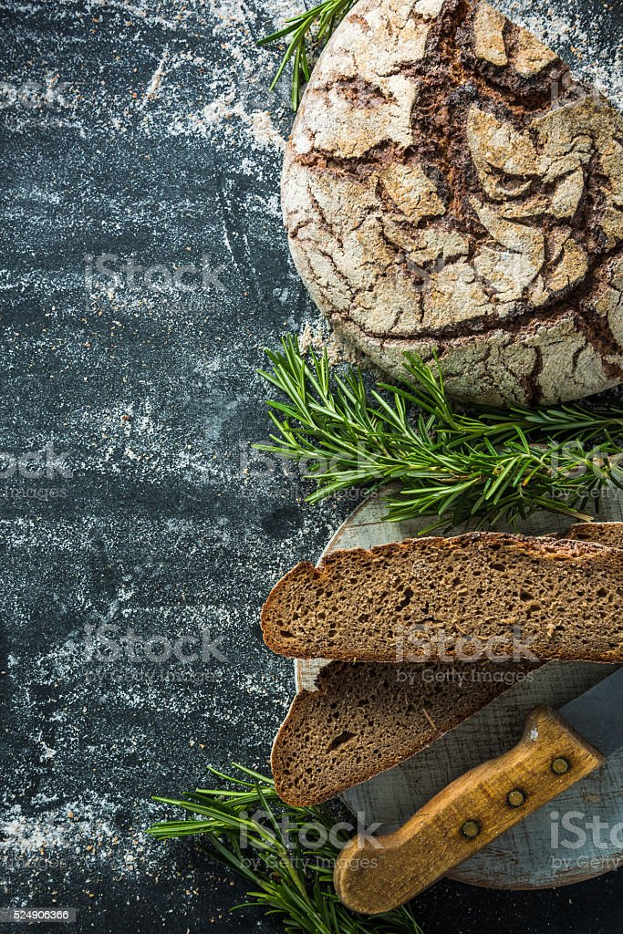 sliced rye artisan bread loaf stock photo