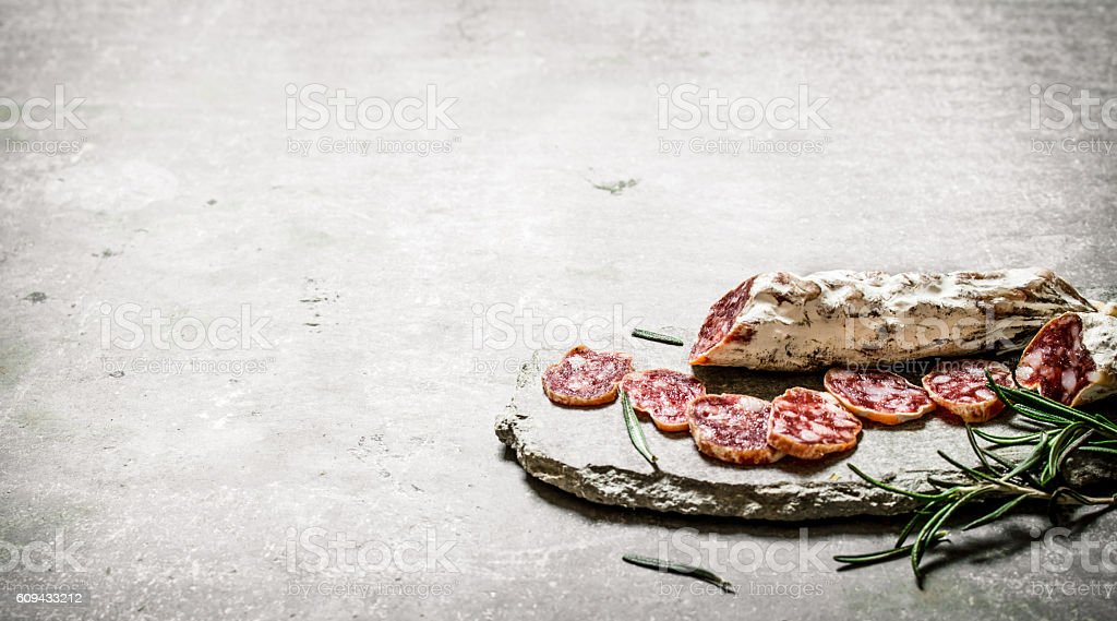 Sliced salami flavored with rosemary and spices. stock photo