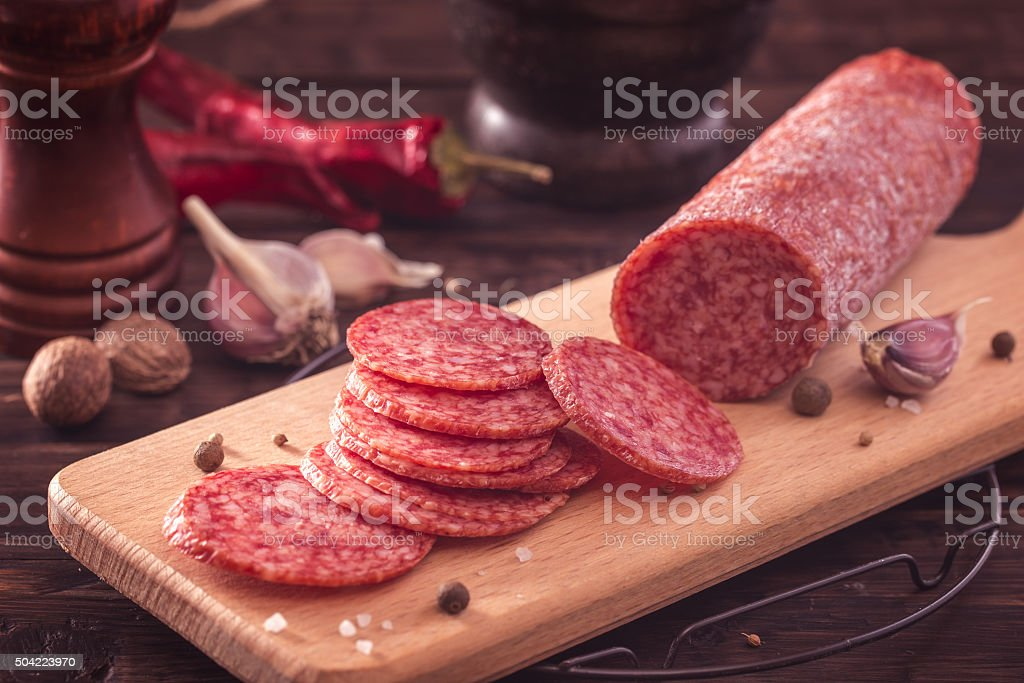 Sliced salami on board stock photo