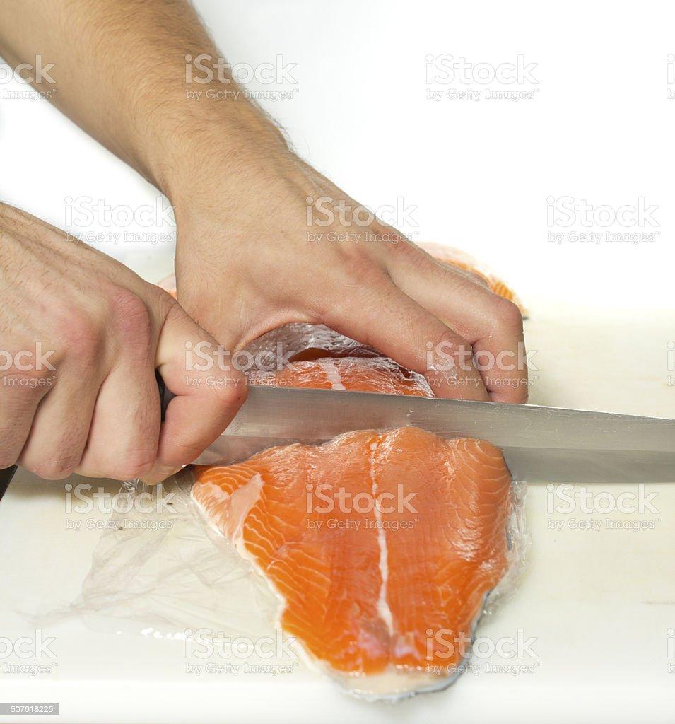 sliced salmon processing stock photo