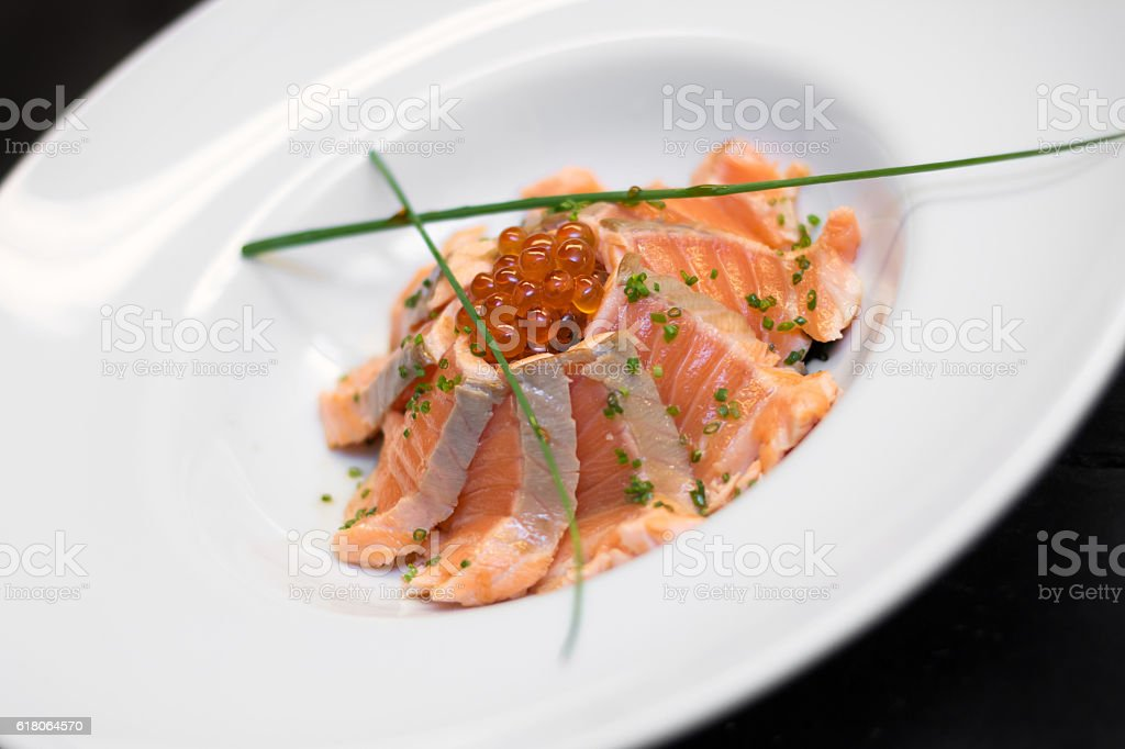 Sliced salmon with red caviar stock photo