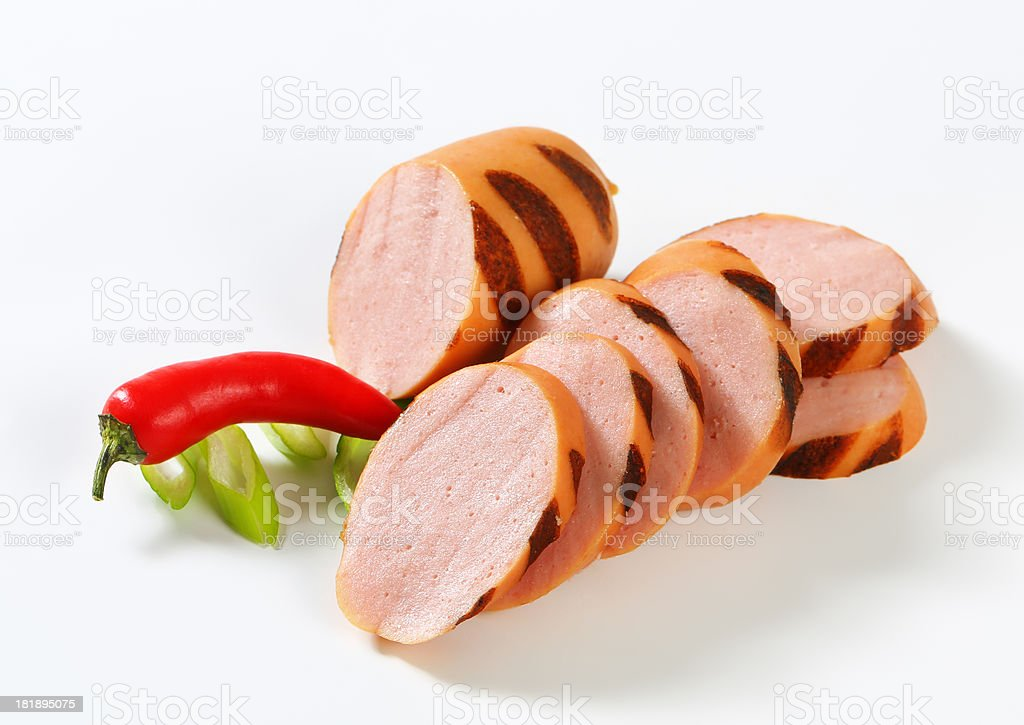 sliced sausage and chili pepper royalty-free stock photo