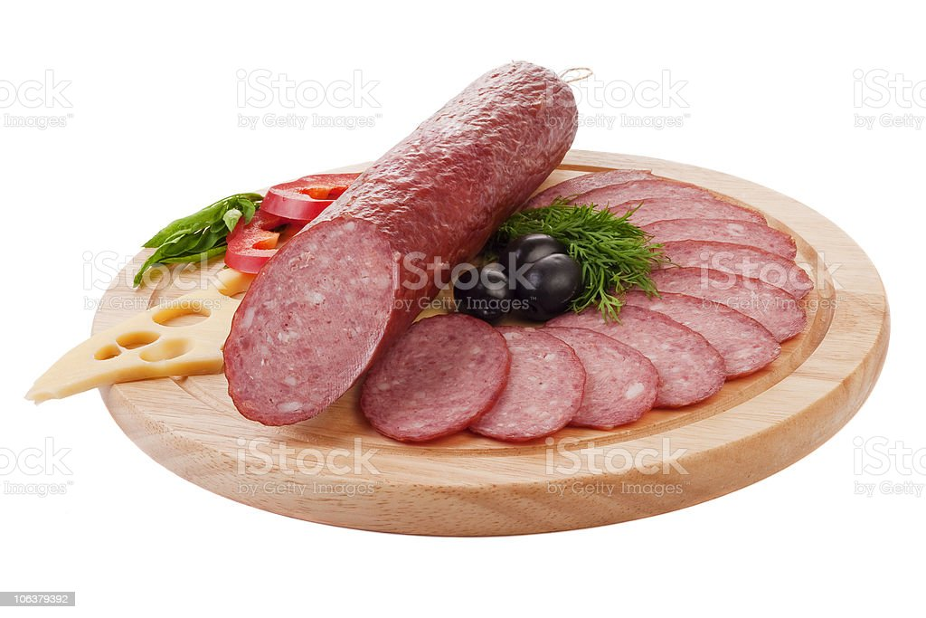Sliced sausage with vegetables royalty-free stock photo