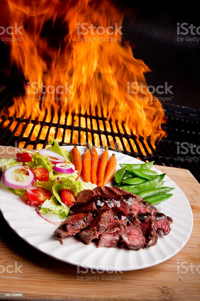 Sliced Sirloin Beef Steak with Flame Background royalty-free stock photo