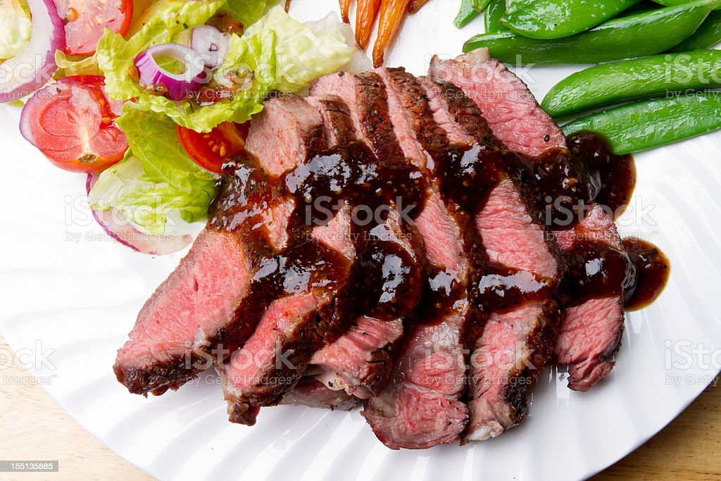 Sliced Sirloin Beef Steak with Salad, Veggies and Gravy royalty-free stock photo