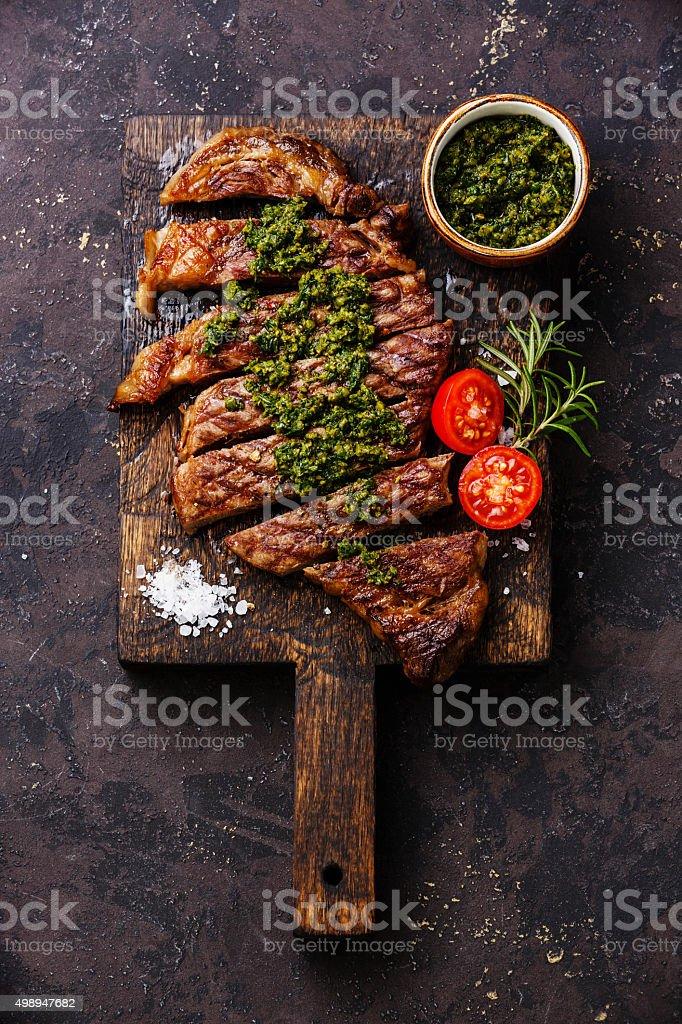 Sliced Sirloin steak with chimichurri sauce stock photo