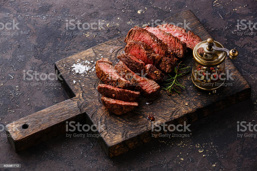 Sliced steak and pepper mill stock photo