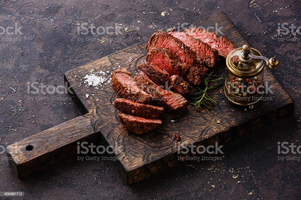 Sliced steak and pepper mill stock photo